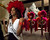 Miss Universe 2011 Leila Lopes of Angola tries on a Jubilee head piece as the Jubilee Show dancers wait for her during a tour at Bally's in Las Vegas, Nevada December 6, 2012. The Miss Universe 2012 competition will be held on December 19. REUTERS/Matt Brown/Miss Universe Organization L.P/Handout