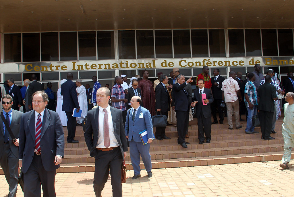 Description of . International officials leave Bamako's Conference Centre after attending the 4th meeting of the support and follow-up group on the situation in Mali, on April 19, 2013 in Bamako. HABIBOU KOUYATE/AFP/Getty Images