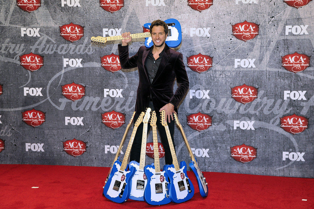 Description of . Singer Luke Bryan poses in the press room with multiple awards backstage at the American Country Awards on Monday, Dec. 10, 2012, in Las Vegas. (Photo by Jeff Bottari/Invision/AP)