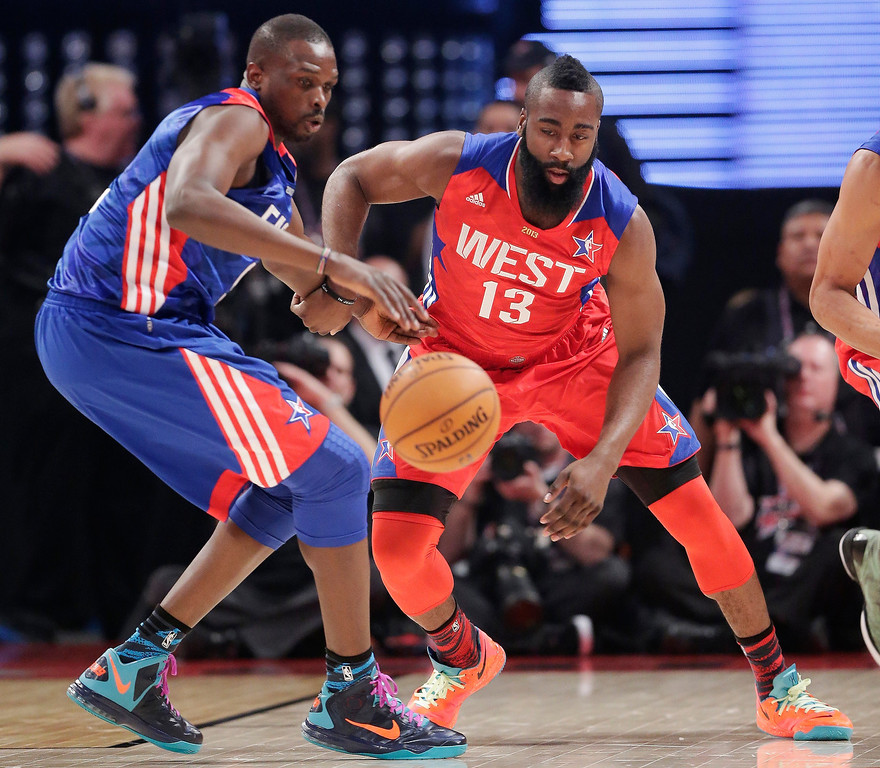 Description of . East Team's  Luol Deng from Great Britain of the Chicago Bulls, left and West Team's James Harden of the Houston Rockets go after a loose ball during the first half of the NBA All-Star basketball game Sunday, Feb. 17, 2013, in Houston. (AP Photo/Eric Gay)