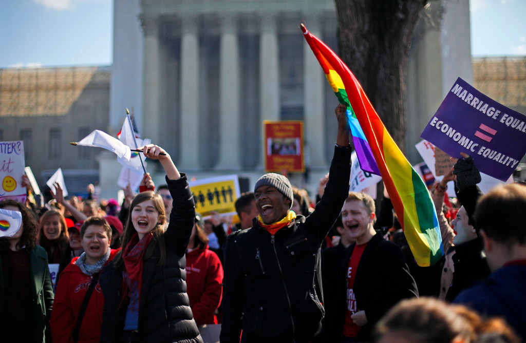 Description of . Demonstrators chant outside the Supreme Court in Washington, Tuesday, March 26, 2013, as the court heard arguments on California\'s voter approved ban on same-sex marriage, Proposition 8. (AP Photo/Pablo Martinez Monsivais)