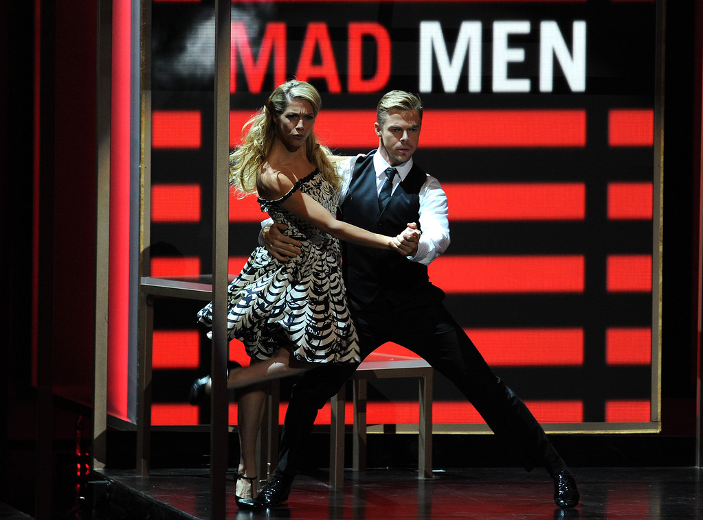 Description of . Choreographer Derek Hough (L) performs onstage during the 65th Annual Primetime Emmy Awards held at Nokia Theatre L.A. Live on September 22, 2013 in Los Angeles, California.  (Photo by Kevin Winter/Getty Images)