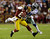 LANDOVER, MD - DECEMBER 30:  Santana Moss #89 of the Washington Redskins is tackled  by Mike Jenkins #21 of the Dallas Cowboys after catching a pass in the first quarter at FedExField on December 30, 2012 in Landover, Maryland.  (Photo by Rob Carr/Getty Images)
