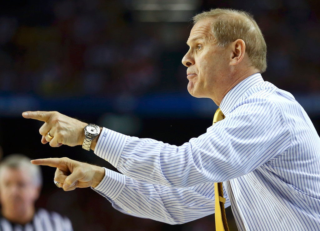Description of . Michigan Wolverines head coach John Beilein directs his team\'s play against the Louisville Cardinals in the first half of their NCAA men\'s Final Four championship basketball game in Atlanta, Georgia April 8, 2013.  REUTERS/Jeff Haynes