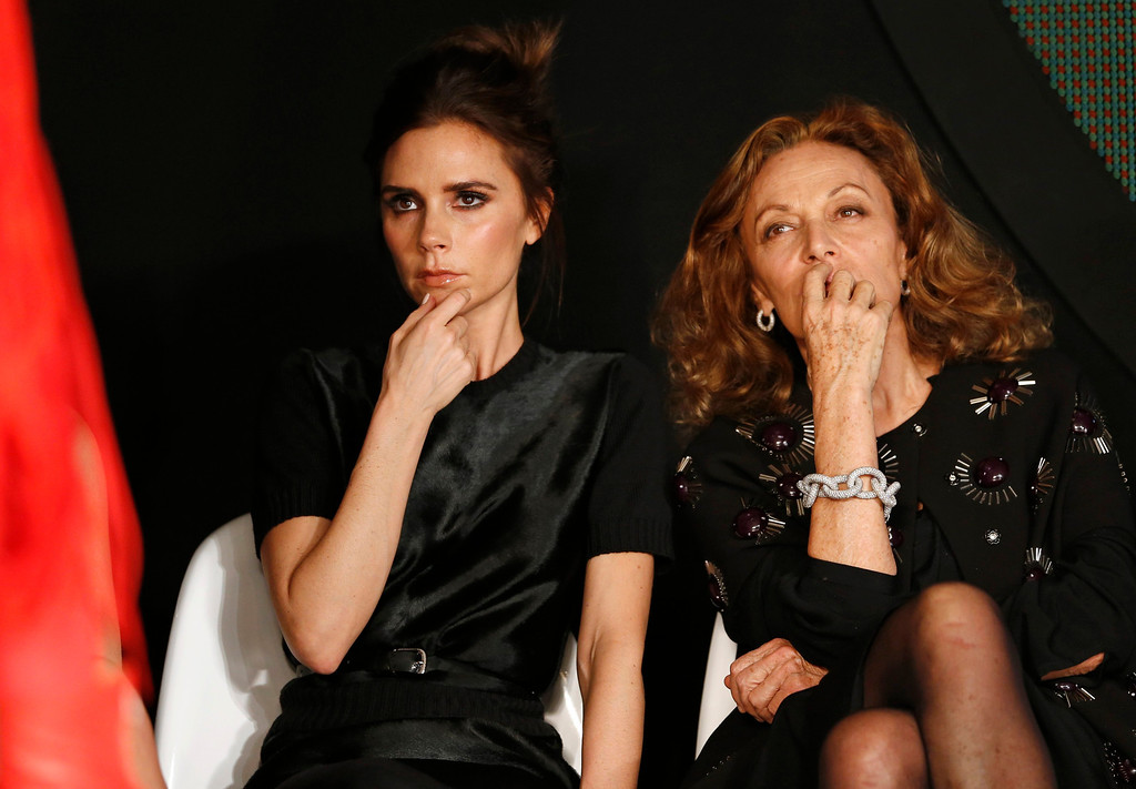 Description of . Designer and former Spice Girl Victoria Beckham (L) and designer Diane Von Furstenberg judge the Woolmark Prize during London Fashion Week, February 16, 2013. REUTERS/Olivia Harris