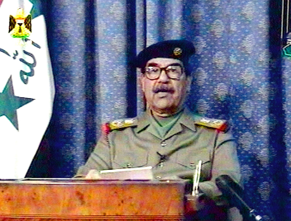 Description of . Iraqi President Saddam Hussein appears on Iraqi television Thursday, March 20, 2003, a few hours after the first U.S. cruise missiles and bombs fell on Baghdad. In the nationally televised address, Saddam accused the United States of committing a shameful crime by attacking Iraq. (AP Photo/Iraqi TV via APTN)