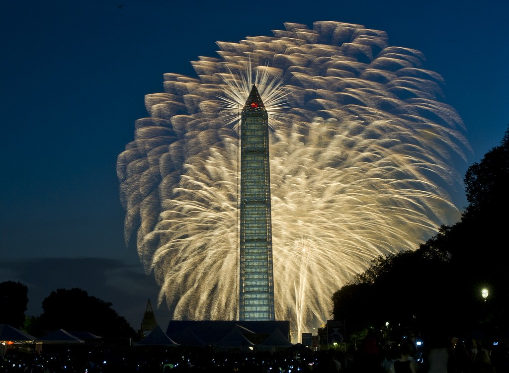 Description of . Fourth of July Independence Day fireworks are seen over the Washington Monument, July 4, 2013 in Washington, MLADEN ANTONOV/AFP/Getty Images