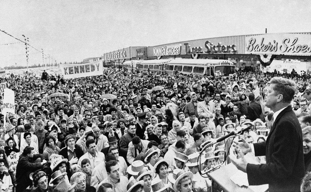 Description of . Sen. Kennedy  speaks at a shopping center in Warren, Mich., on Oct. 26, 1960. It was one of several shopping centers the Democratic candidate for president visited during his visit to neighboring towns around Detroit. Associated Press file