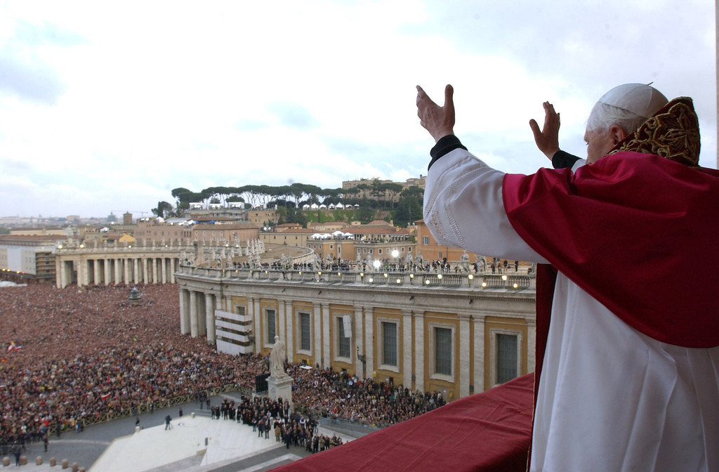 Description of . Newly elected Pope Cardindal Joseph Ratzinger, Pope Benedetto XVI gestures to the crowd in St. Peter's square April 19, 2005 in Vatican City. The 265th Pope will lead the world's 1 billion Catholics.  (Photo by Arturo Mari-Pool/Getty Images)