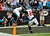 Carolina Panthers quarterback Cam Newton (1) dives into the end zone for a touchdown as Atlanta Falcons' Chris Owens (21) pursues during the second half of an NFL football game in Charlotte, N.C., Sunday, Dec. 9, 2012. (AP Photo/Rainier Ehrhardt)
