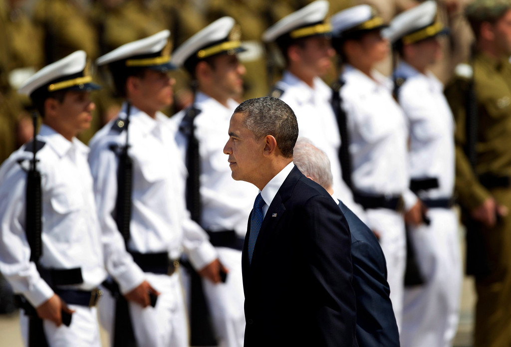Description of . US President Barack Obama reviews an honor guard upon his arrival at Ben Gurion airport near Tel Aviv, Israel, Wednesday, March 20, 2013. (AP Photo/Ariel Schalit)