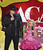 LAS VEGAS, NV - DECEMBER 10:  Hosts Trace Adkins (L) and Kristin Chenoweth speak onstage during the 2012 American Country Awards at the Mandalay Bay Events Center on December 10, 2012 in Las Vegas, Nevada.  (Photo by Mark Davis/Getty Images)