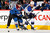 Chuck Kobasew #12 of the Colorado Avalanche and Kevin Shattenkirk #22 of the St. Louis Blues battle for control of the puck at the Pepsi Center on February 20, 2013 in Denver, Colorado.  (Photo by Doug Pensinger/Getty Images)