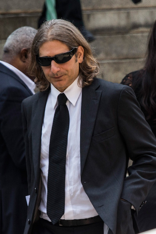 Description of . Actor Michael Imperioli leaves after attending the funeral for Actor James Gandolfini at The Cathedral Church of St. John the Divine on June 27, 2013 in New York City.  (Photo by Andrew Burton/Getty Images)
