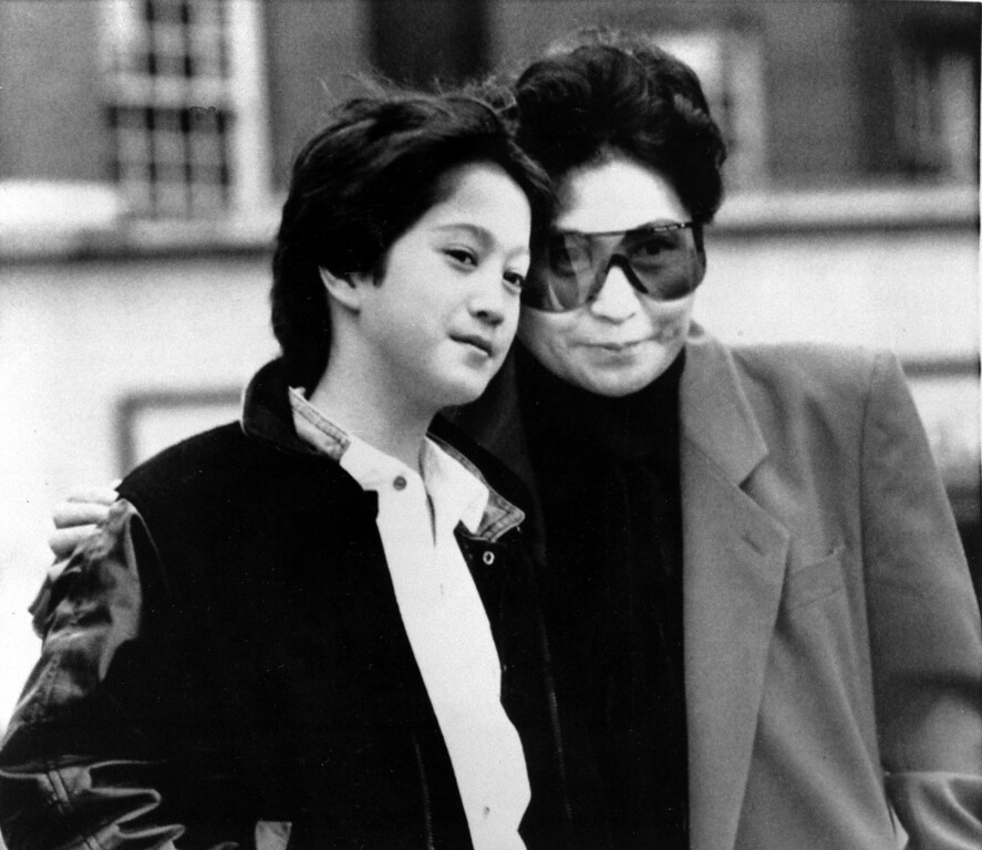 Description of . Yoko Ono, widow of John Lennon, and their son, Sean, 10, are shown in London, England, March 20, 1986.  Ono will perform in concert at the Wembley Conference Center on her Starpeace Tour, taking in 33 cities in seven weeks.  (AP Photo/Richard Price)