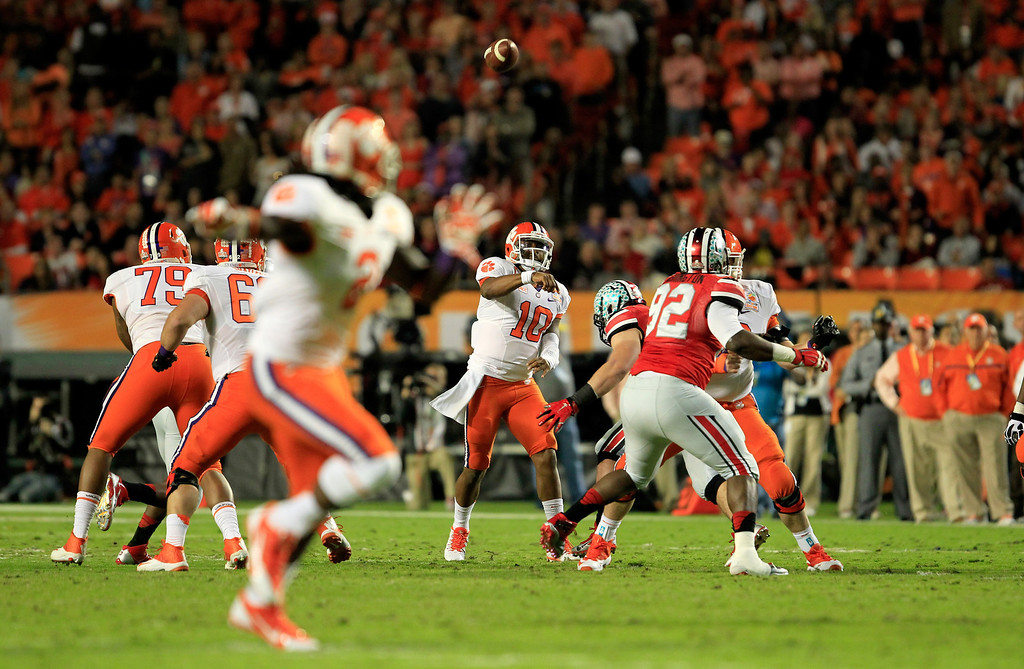 Description of . MIAMI GARDENS, FL - JANUARY 03: Tajh Boyd #10 of the Clemson Tigers throws a touchdown pass to Sammy Watkins #2 in the first quarter against the Ohio State Buckeyes during the Discover Orange Bowl at Sun Life Stadium on January 3, 2014 in Miami Gardens, Florida.  (Photo by Chris Trotman/Getty Images)