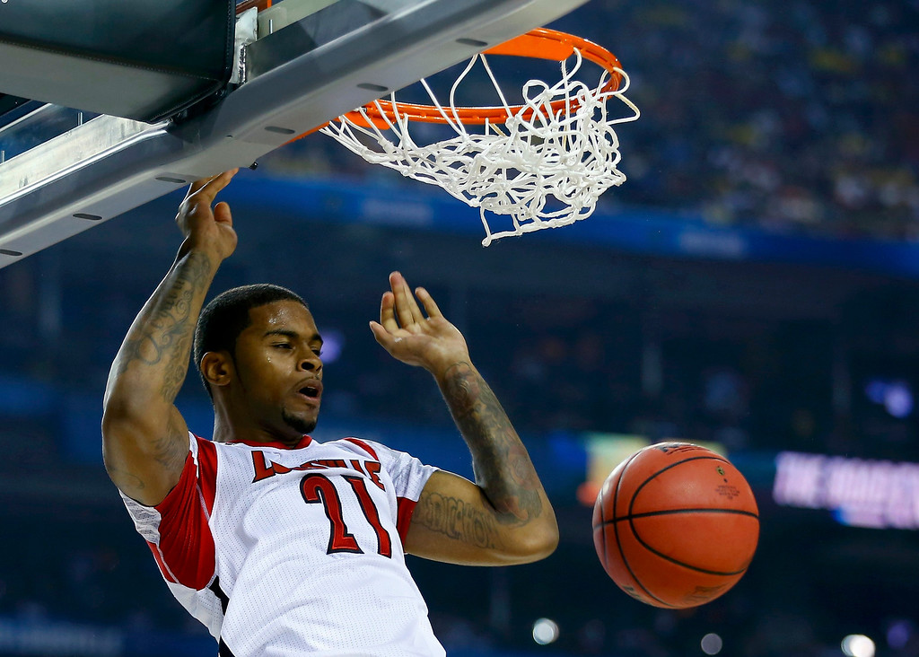 Description of . Louisville Cardinals forward Chane Behanan dunks against the Michigan Wolverines during the first half of their NCAA men's Final Four championship basketball game in Atlanta, Georgia April 8, 2013. REUTERS/Jeff Haynes