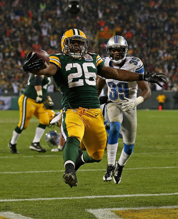 Description of . GREEN BAY, WI - DECEMBER 09: DuJuan Harris #26 of the Green Bay Packers scores a touchdown in front of Ricardo Silva #39 of the Detroit Lions at Lambeau Field on December 9, 2012 in Green Bay, Wisconsin. The Packers defeated the Lions 27-20. (Photo by Jonathan Daniel/Getty Images)