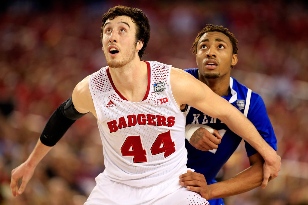 Description of . ARLINGTON, TX - APRIL 05: Frank Kaminsky #44 of the Wisconsin Badgers boxes out James Young #1 of the Kentucky Wildcats during the NCAA Men's Final Four Semifinal at AT&T Stadium on April 5, 2014 in Arlington, Texas.  (Photo by Jamie Squire/Getty Images)