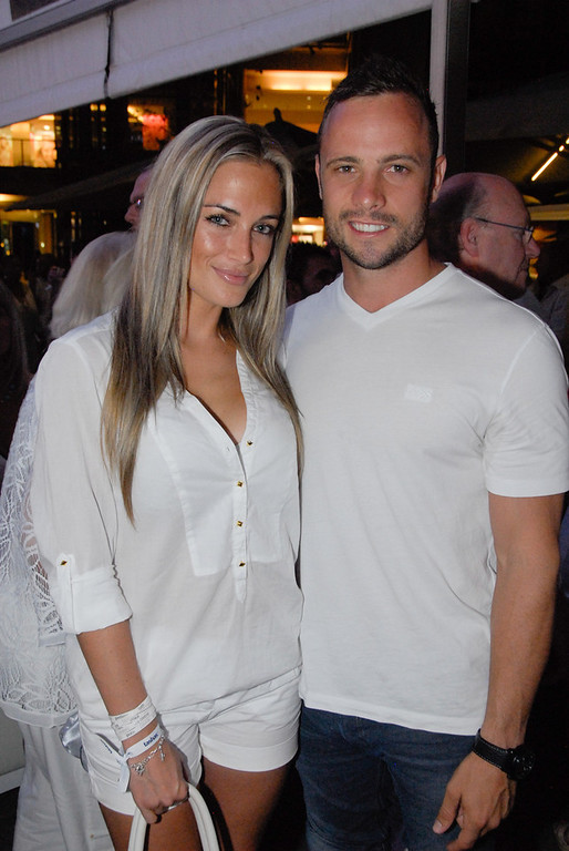 Description of . A picture taken on January 26, 2013 shows Olympian sprinter Oscar Pistorius posing next to his girlfriend  Reeva Steenkamp at Melrose Arch in Johannesburg. South Africa's Olympic sprinter Oscar
