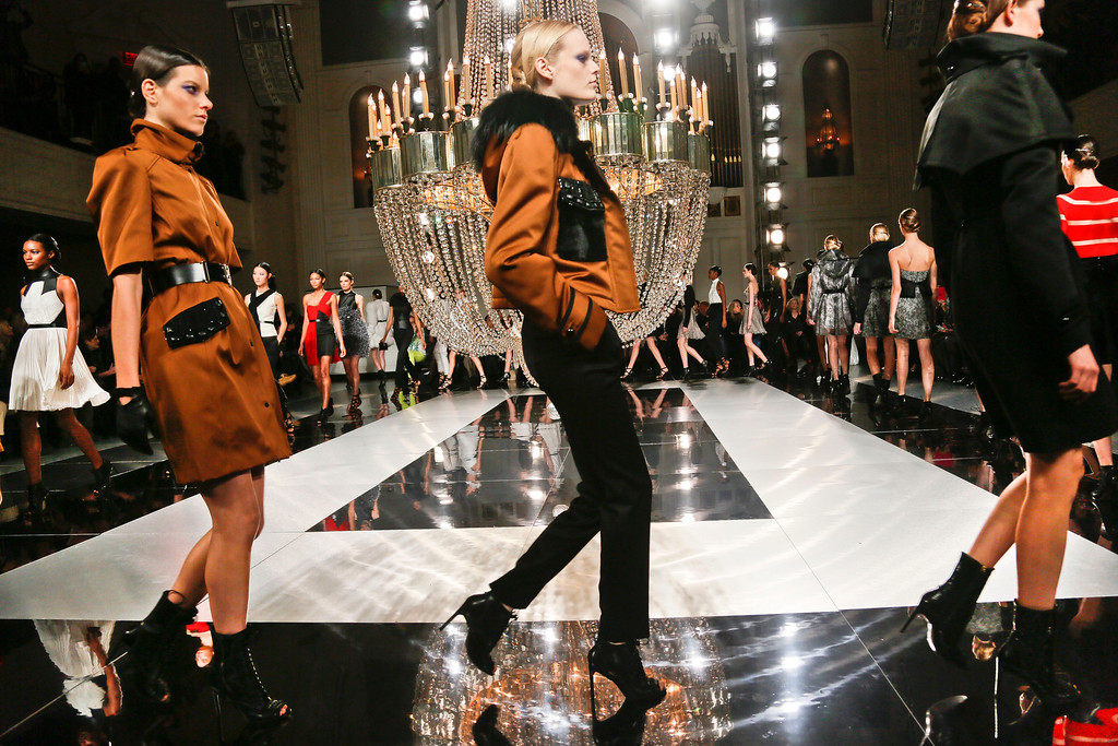 Description of . Fashion from the Fall 2013 collection of Jason Wu is modeled on Friday, Feb. 8, 2013 in New York.  (AP Photo/Bebeto Matthews)
