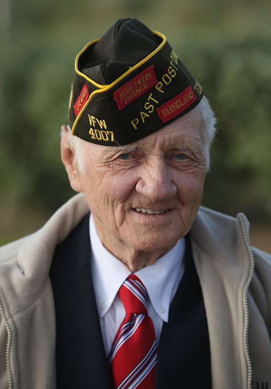 Description of . D-Day veteran Travis Winfree, 89, who served in the 29th Infantry Division of the U.S. Army, landed at Omaha Beach and is from Hempstead, Texas, attends the U.S. D-Day Ceremony on June 5, 2014 at Utah Beach, France. (Photo by Sean Gallup/Getty Images)