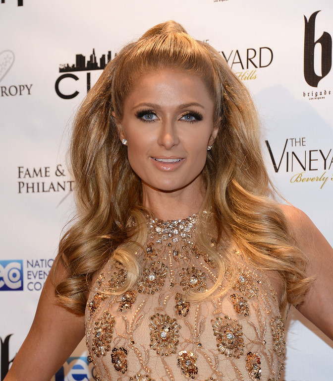 Description of . Paris Hilton attends the Fame and Philanthropy Post-Oscar Party at The Vineyard on March 2, 2014 in Beverly Hills, California.  (Photo by Jason Kempin/Getty Images)