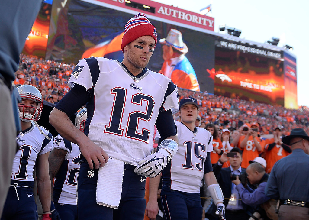 Description of . New England Patriots quarterback Tom Brady (12) takes the field before the game. The Denver Broncos take on the New England Patriots in the AFC Championship game at Sports Authority Field at Mile High in Denver on January 19, 2014. (Photo by AAron Ontiveroz/The Denver Post)