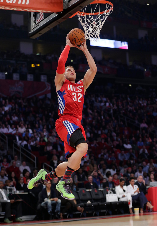 Description of . West Team's Blake Griffin of the Los Angeles Clippers dunks against the East Team during the first half of the NBA All-Star basketball game Sunday, Feb. 17, 2013, in Houston. (AP Photo/Eric Gay)