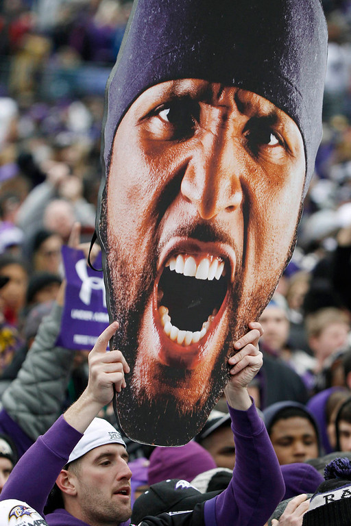 Description of . A fan of Super Bowl XLVII champion Baltimore Ravens holds up a large cut-out of retiring linebacker Ray Lewis before a stadium rally in Baltimore February 5, 2013. The Ravens defeated the San Francisco 49ers to win the NFL championship.     REUTERS/Gary Cameron