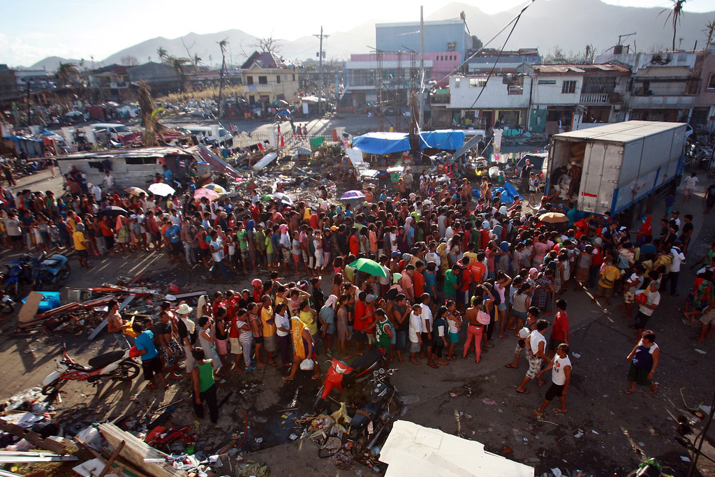 Description of . Residents wait for their turn to get relief supplies in Tacloban Hospital on November 15, 2013 in Tacloban, Philippines. (Jeoffrey Maitem/Getty Images)