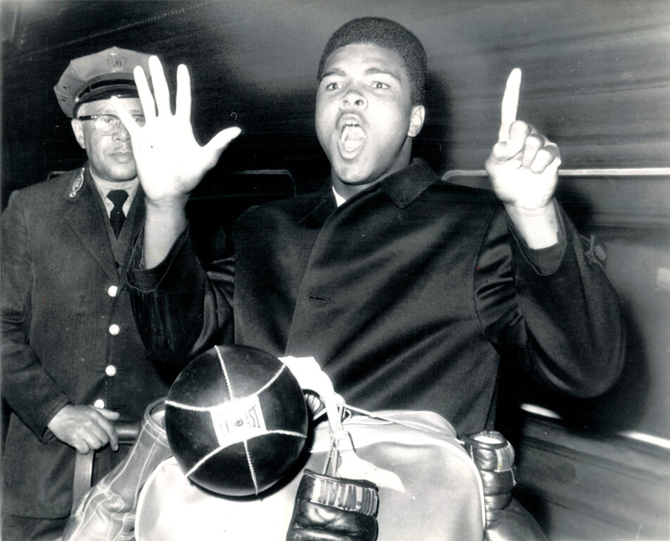 Description of . Cassius Clay, brash young heavyweight, holds up six fingers to denote the round in which he expects to demolish Doug Jones when they tangle in Madison Square Garden Wednesday.  Clay arrived in New York from Miami where he spent much of his time needling Sonny Liston.  Jones' response to Clay's latest poems.