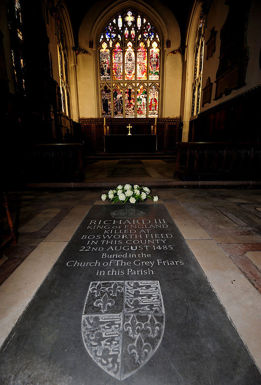 """. A general view of a memorial stone to King Richard III, inside Leicester Cathedral, England, Monday Feb. 4, 2013. Leicester University declared Monday that the remains  found underneath a car park last September at the Grey Friars excavation in Leicester, were \""""beyond reasonable doubt\"""" to be the long lost remains of England\'s King Richard III, missing for 500 years.  Richard was immortalized in a play by  Shakespeare as a hunchbacked usurper who left a trail of bodies including those of his two young nephews, murdered in the Tower of London on his way to the throne.(AP Photo/PA, Rui Vieira)"""