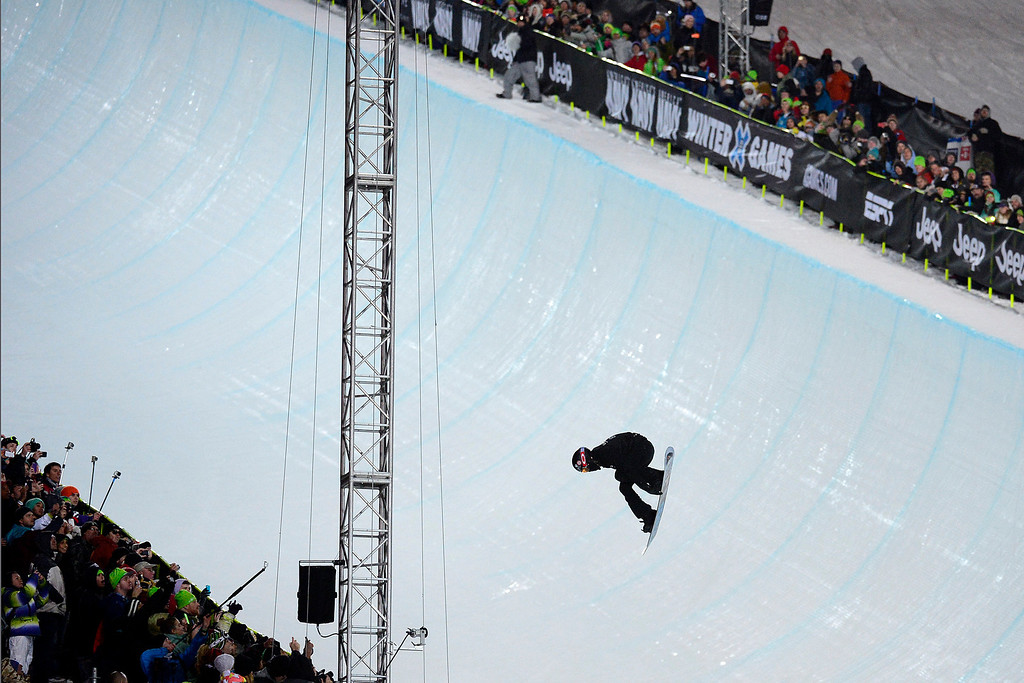 Description of . ASPEN, CO. - JANUARY 26:  Shaun White catches air during his first run in the men's snowboard superpipe finals. White went on to win gold for the sixth time in this event. The 2013 Aspen X Games on Buttermilk Mountain on January 27, 2013. (Photo By Mahala Gaylord / The Denver Post)