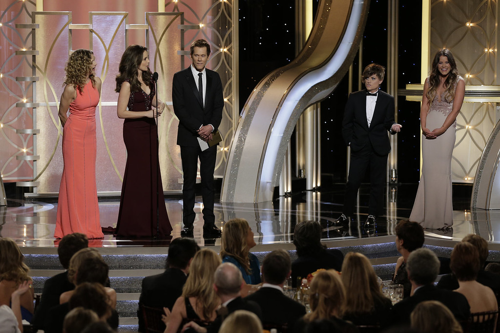 Description of . In this handout photo provided by NBCUniversal, (L-R) Presenter Kyra Sedgwick, Host Tina Fey, Presenter Kevin Bacon, Host Amy Poehler and Miss Golden Globe Sosie Bacon speak onstage during the 71st Annual Golden Globe Award at The Beverly Hilton Hotel on January 12, 2014 in Beverly Hills, California.  (Photo by Paul Drinkwater/NBCUniversal via Getty Images)
