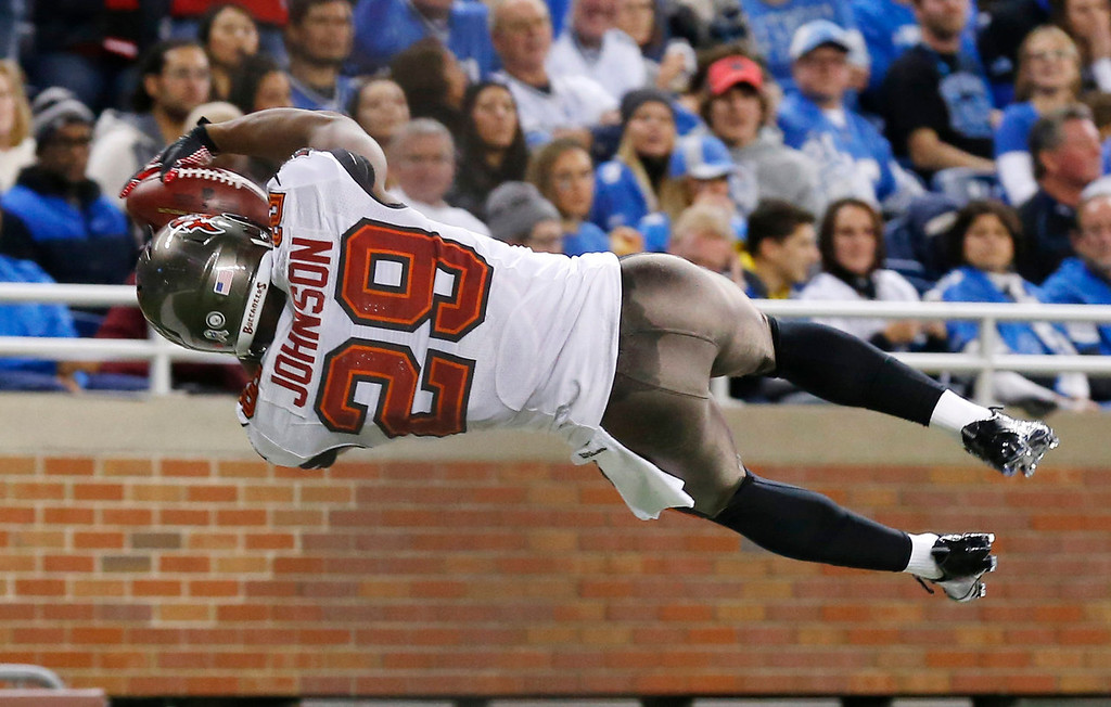 Description of . Tampa Bay Buccaneers cornerback Leonard Johnson (29) jumps into the end zone after a 48-yard interception for a touchdown during the first half of an NFL football game against the Detroit Lions in Detroit, Sunday, Nov. 24, 2013. (AP Photo/Paul Sancya)
