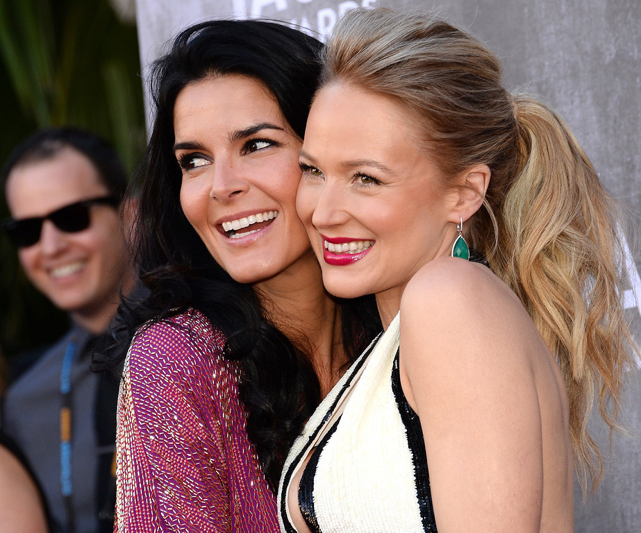 Description of . Angie Harmon, left, and Jewel arrive at the 49th annual Academy of Country Music Awards at the MGM Grand Garden Arena on Sunday, April 6, 2014, in Las Vegas. (Photo by Al Powers/Powers Imagery/Invision/AP)