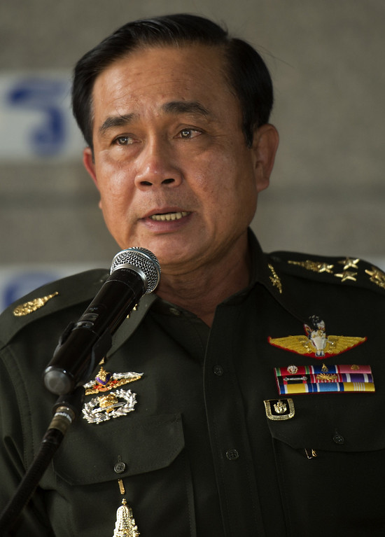 Description of . Thai Army chief General Prayut Chan-O-Cha answers a question during a press conference at the Army Club in Bangkok on May 20, 2014. Thailand's army declared martial law after months of deadly anti-government protests, deploying armed troops in central Bangkok and censoring the media but insisting the move was