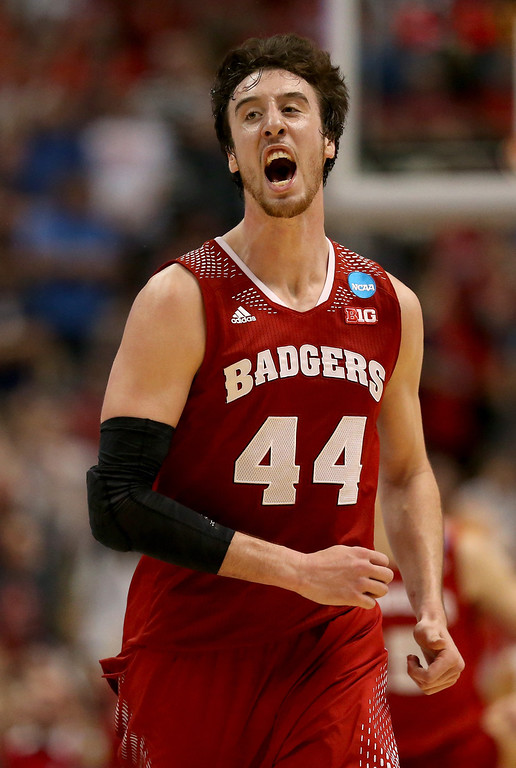 Description of . Frank Kaminsky #44 of the Wisconsin Badgers celebrates after making a three-pointer in the second half while taking on the Arizona Wildcats during the West Regional Final of the 2014 NCAA Men's Basketball Tournament at the Honda Center on March 29, 2014 in Anaheim, California.  (Photo by Jeff Gross/Getty Images)