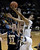 University of Colorado's Sabatino Chen goes for a layup over Max Jacobsen during a game against Northern Arizona on Friday, Dec. 21, at the Coors Event Center on the CU campus in Boulder.    (Jeremy Papasso/Daily Camera)