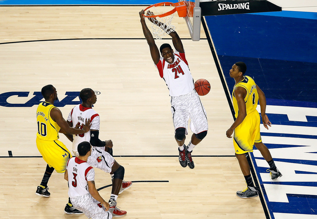 Description of . Montrezl Harrell #24 of the Louisville Cardinals dunks an alley-op pass in the first half against Glenn Robinson III #1 of the Michigan Wolverines vduring the 2013 NCAA Men's Final Four Championship at the Georgia Dome on April 8, 2013 in Atlanta, Georgia.  (Photo by Kevin C. Cox/Getty Images)