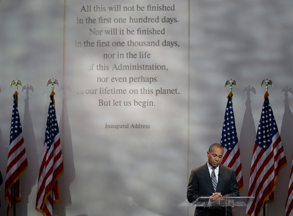 Description of . Massachusetts Gov. Deval Patrick calls for a moment of silence at 1:58 PM EST to mark the time of death for President Kennedy during a ceremony to commemorate the 50th anniversary of Kennedy's assassination at the John F. Kennedy Library and Museum in Boston, on Friday, Nov. 22, 2013. Kennedy, the 35th President of the United State, was assassinated in Dallas, Texas 50 years ago today. (AP Photo/Stephan Savoia)