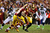 Robert Griffin III #10 laterals to Alfred Morris #46 of the Washington Redskins in the third quarter against the Seattle Seahawks during the NFC Wild Card Playoff Game at FedExField on January 6, 2013 in Landover, Maryland.  (Photo by Al Bello/Getty Images)