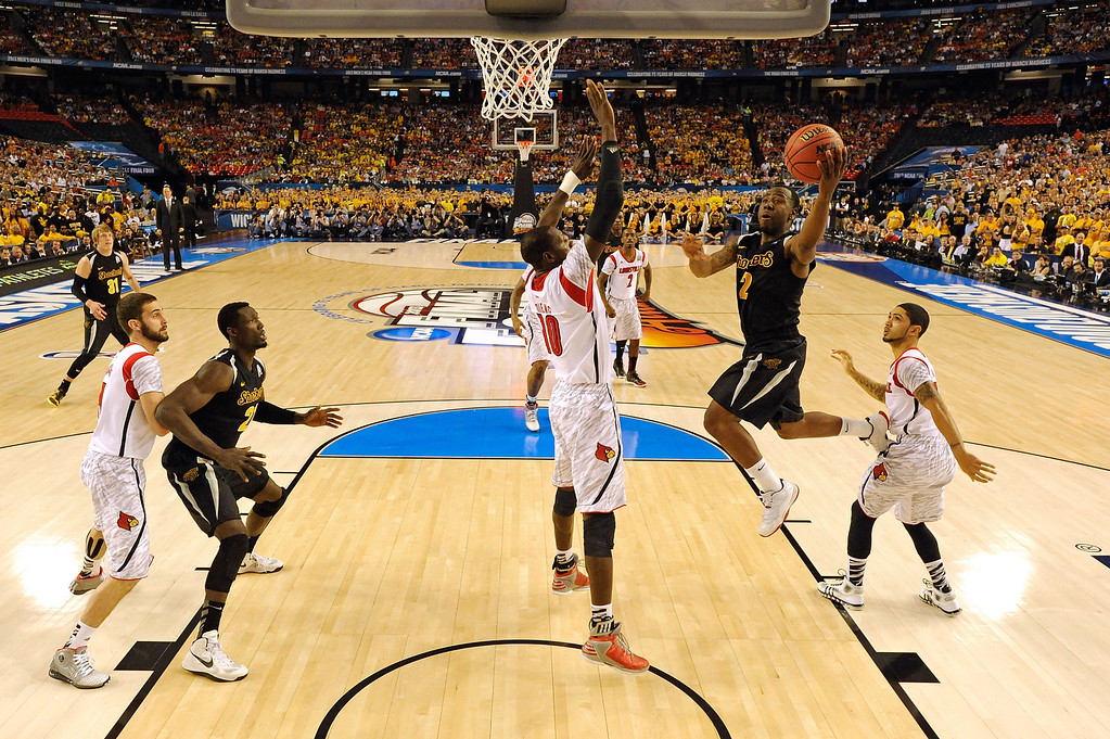 Description of . ATLANTA, GA - APRIL 06:  Malcolm Armstead #2 of the Wichita State Shockers drives for a shot attempt in the first half against Gorgui Dieng #10 of the Louisville Cardinals during the 2013 NCAA Men's Final Four Semifinal at the Georgia Dome on April 6, 2013 in Atlanta, Georgia.  (Photo by Chris Steppig-Pool/Getty Images)