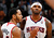 Devin Harris #34 reacts with Josh Smith #5 of the Atlanta Hawks after Smith drew a foul on a dunk against the Denver Nuggets in the final minutes at Philips Arena on December 5, 2012 in Atlanta, Georgia.   (Photo by Kevin C. Cox/Getty Images)