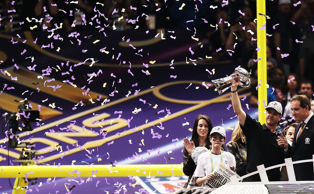Description of . Head coach John Harbaugh of the Baltimore Ravens celebrates with the Vince Lombardi trophy next to his wife Ingrid and his daughter Alison after the Ravens won 34-31 against the San Francisco 49ers during Super Bowl XLVII at the Mercedes-Benz Superdome on February 3, 2013 in New Orleans, Louisiana.  (Photo by Win McNamee/Getty Images)