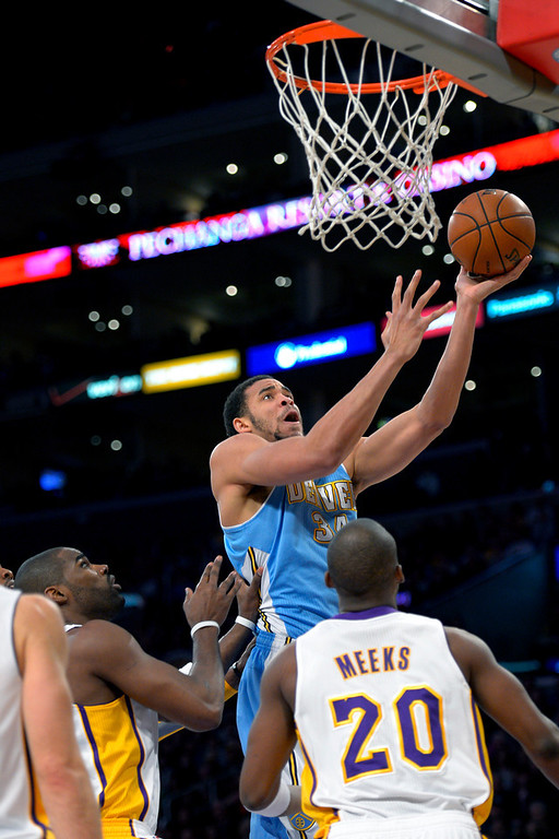 Description of . Denver Nuggets center JaVale McGee (34) goes to the basket over Los Angeles Lakers' Jodie Meeks during the first half of their NBA basketball game, Sunday, Jan. 6, 2013, in Los Angeles. (AP Photo/Mark J. Terrill)