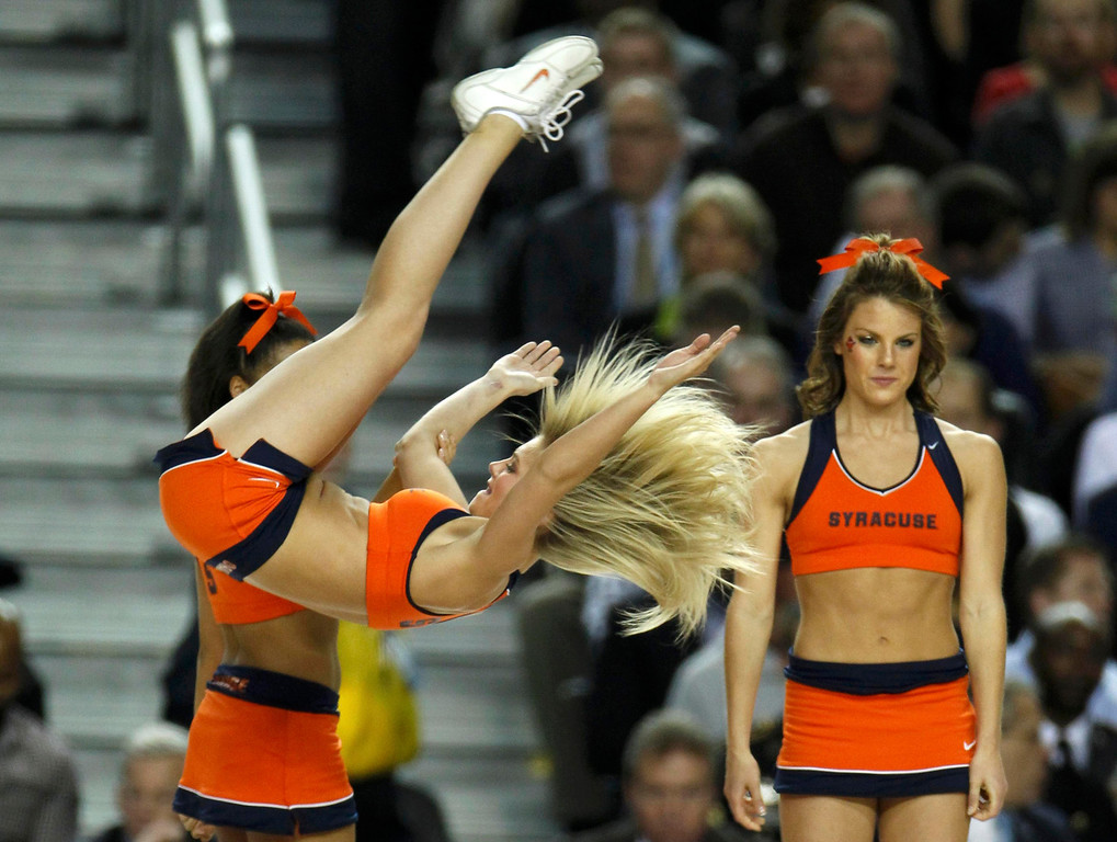 Description of . Syracuse Orange cheerleaders perform during a time-out in their game against the Michigan Wolverines in their NCAA men's Final Four basketball game in Atlanta, Georgia April 6, 2013. REUTERS/Tami Chappell