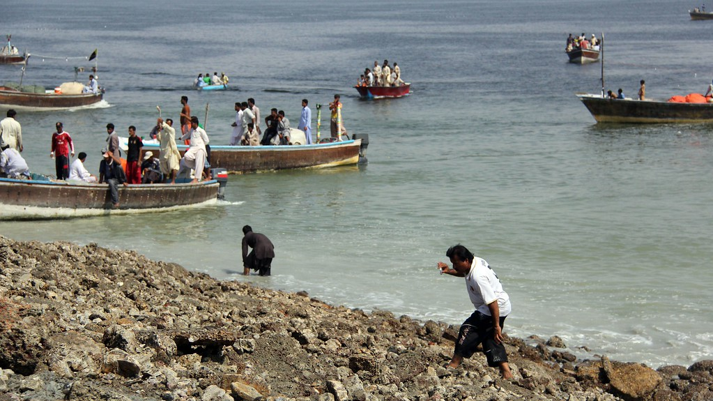 Description of . This photograph taken on September 25, 2013, shows Pakistani residents as they arrive by boat to an island that appeared some two kilometres off the coastline at Gwadar after an earthquake. A small island of mud and rock created by the huge earthquake that hit southwest Pakistan has fascinated locals but experts -- who found methane gas rising from it -- say it is unlikely to last long. The 7.7-magnitude quake struck on September 24, in Baluchistan's remote Awaran district, killing at least 271 people and affecting hundreds of thousands. AFP PHOTO / Behram BALOCH/AFP/Getty Images