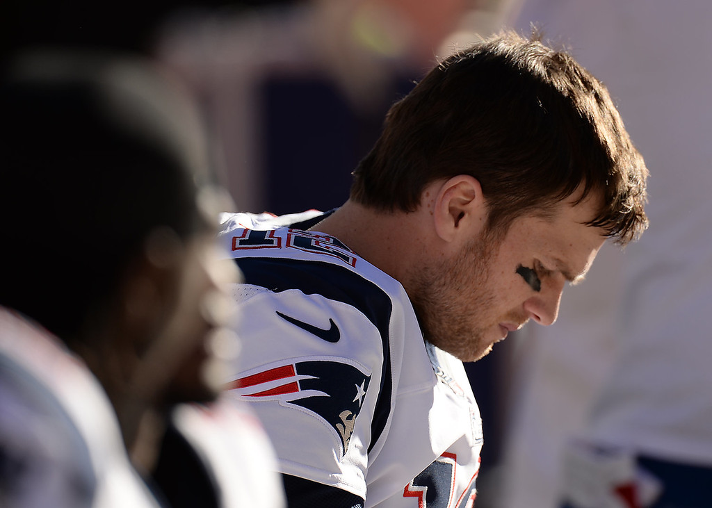 Description of . New England Patriots quarterback Tom Brady (12) sits on the bench in the second quarter. The Denver Broncos take on the New England Patriots in the AFC Championship game at Sports Authority Field at Mile High in Denver on January 19, 2014. (Photo by Hyoung Chang/The Denver Post)